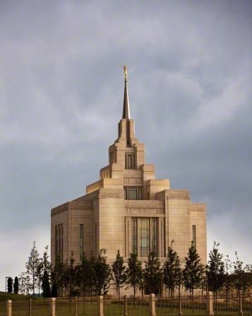 The front of the Kyiv Ukraine Temple in the early evening, with a lot of small trees growing on the grounds.
