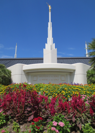 "The engraving on the Las Vegas Nevada Temple that says, ""Holiness to the Lord: The House of the Lord,"" with flowers in the foreground."