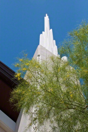 A view of one of the spires on the Las Vegas Nevada Temple from below, looking up toward a blue, cloudless sky.