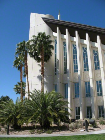 A detailed view of several of the windows on the Las Vegas Nevada Temple, with a few palm trees growing near the building.