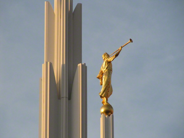 The angel Moroni statue on top of the Las Vegas Nevada Temple, with the stone of another spire seen to the left.