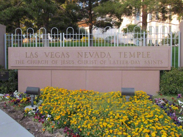 A stone sign on the grounds of the Las Vegas Nevada Temple engraved with the name of the temple and the Church.