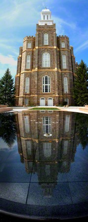 A panoramic view of the Logan Utah Temple, with a pond in the front of the entrance.