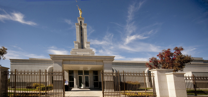 A panoramic view of the Lubbock Texas Temple, with the gate on the temple's fence open and leading to the front door.
