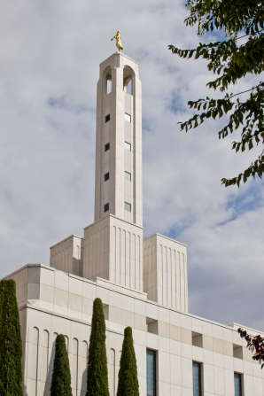 The spire tower with the angel Moroni statue on top of the Madrid Spain Temple, during the daytime.