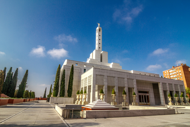 The exterior and grounds of the Madrid Spain Temple on a sunny day.