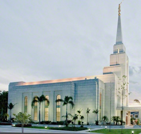A side view of the Manaus Brazil Temple lit up in the late evening.