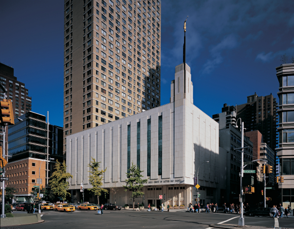 A view of the front entrance and side of the Manhattan New York Temple from across the street.