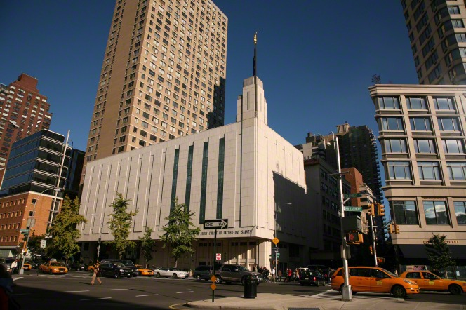 A distant view of the front entrance to the Manhattan New York Temple and surrounding scenery.