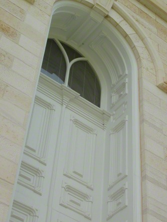 A close-up of a door on the Manti Utah Temple exterior, including arched windows.