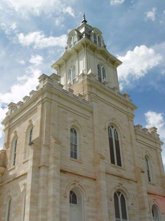 A close-up of one of the Manti Utah Temple spires, with a blue sky and clouds in the distance.