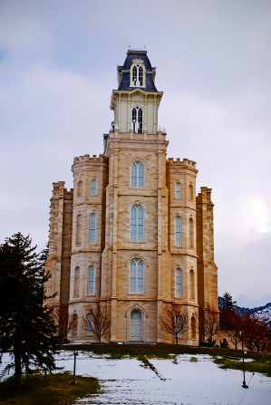A side view of an entrance into the Manti Utah Temple in the wintertime.