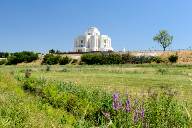 A view of the Meridian Idaho Temple from across a green field.