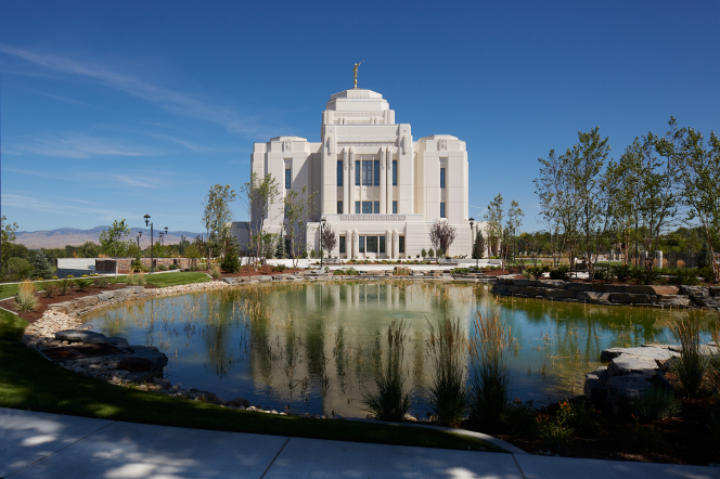 A photograph of the Meridian Idaho Temple overlooking a pond.