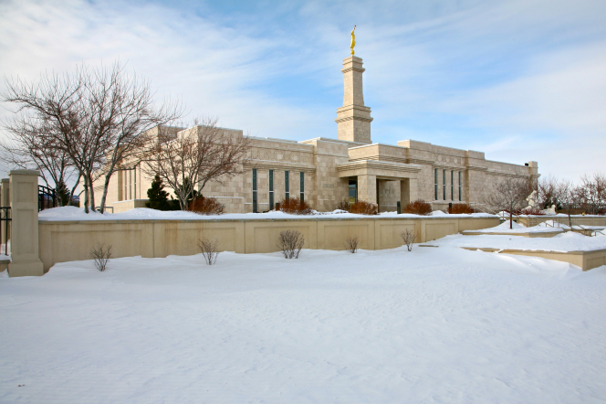 The front side of the Monticello Utah Temple surrounded by a landscape of snow in the wintertime.