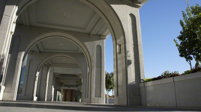The arched path on the Mount Timpanogos Utah Temple leading to one of the main entrances, which is seen in the distance.