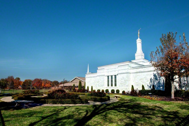 The Nashville Tennessee Temple and grounds in the fall, with fall leaves on the trees and a clear blue sky overhead.