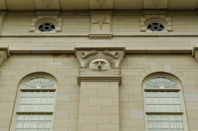 A detail of the sunstone and windows that line the outer walls of the Nauvoo Illinois Temple.