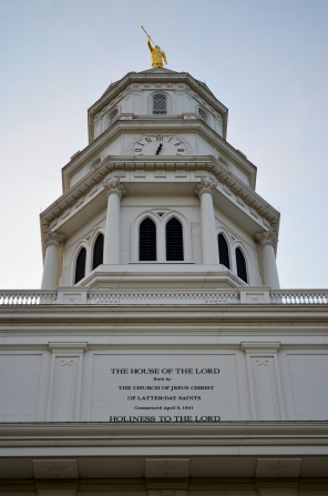 "The spire on the Nauvoo Illinois Temple, topped with a clock and the words ""Holiness to the Lord: The House of the Lord."""