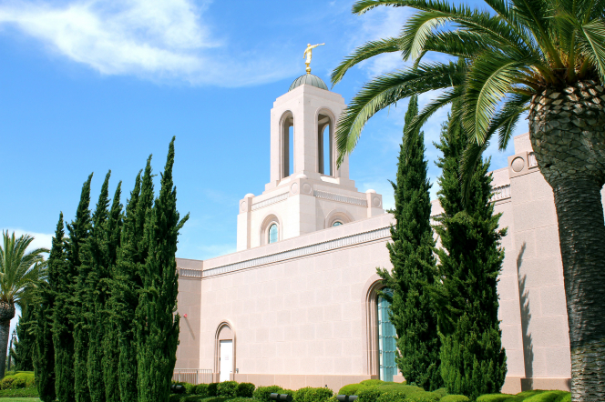 A part of the Newport Beach California Temple, with trees, including a large palm growing near the temple.