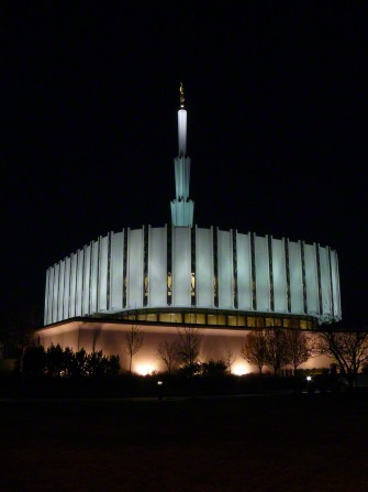 The old version of the Ogden Utah Temple, with the lights on at night and the black sky in the background.