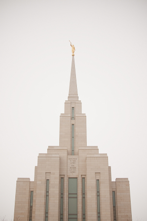The top half of the front of the Oquirrh Mountain Utah Temple, with a white sky up above.