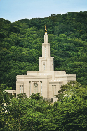 The Panama City Panama Temple seen from afar, amidst a large number of green trees.