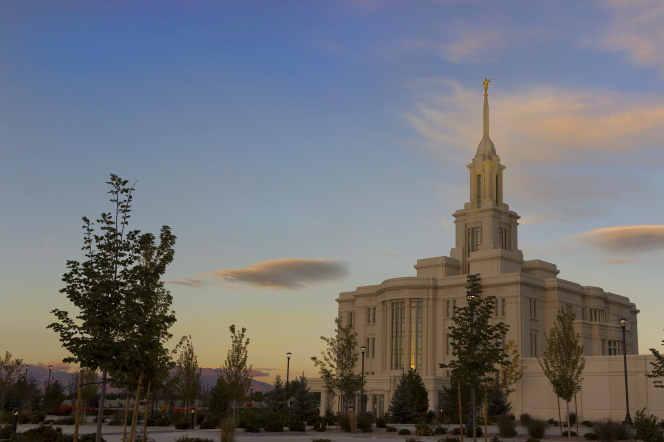 The whole Payson Utah Temple in the evening, including scenery and dark skies.