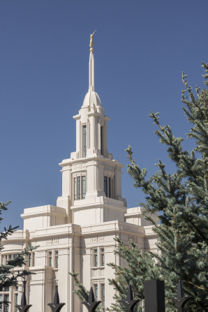 The Payson Utah Temple spire from the south side, including trees.