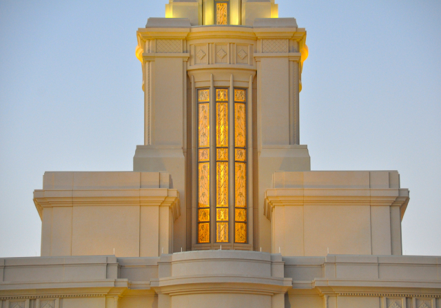A view of the window on the spire of the Payson Utah Temple in the evening.