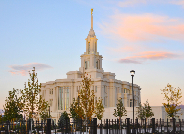 An angle view of the Payson Utah Temple during sunset, including scenery.