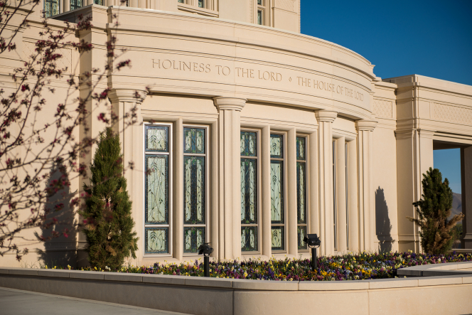"The stained-glass windows of the Payson Utah Temple underneath the inscription ""Holiness to the Lord: The House of the Lord."""