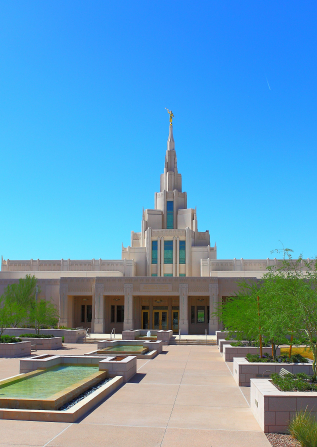 A view of the Phoenix Arizona Temple entrance, including scenery and a clear blue sky.
