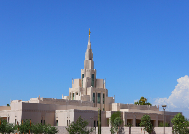 A view of the Phoenix Arizona Temple during the day, including scenery.