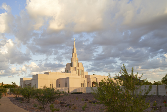 The Phoenix Arizona Temple during sunset, including scenery and a cloudy sky.