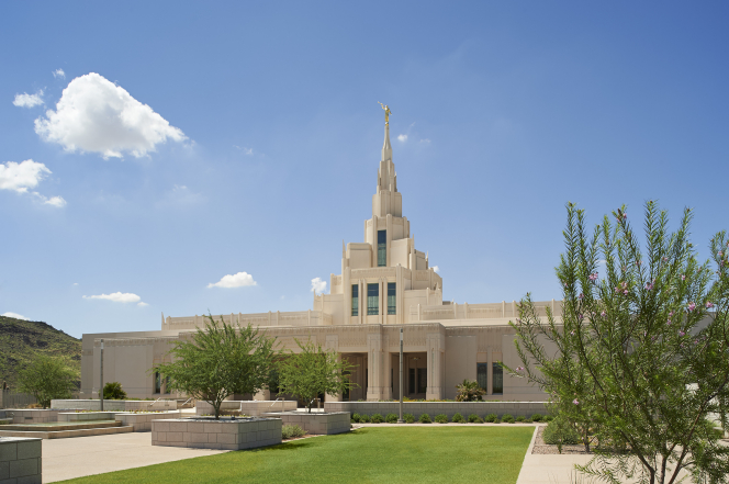 A view of the entrance of the Phoenix Arizona Temple in the daytime with a clear blue sky.