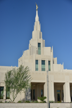A view of the Phoenix Arizona Temple entrance and spire, including scenery.
