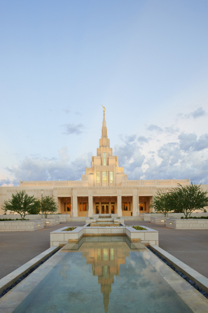 The Phoenix Arizona Temple entrance during sunset, including scenery and the water fountain.