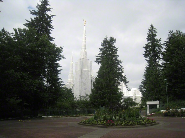 Several spires on the Portland Oregon Temple, seen between the trees that grow near the temple.