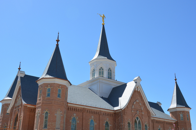 The spires of the Provo City Center Temple with a clear blue sky overhead.