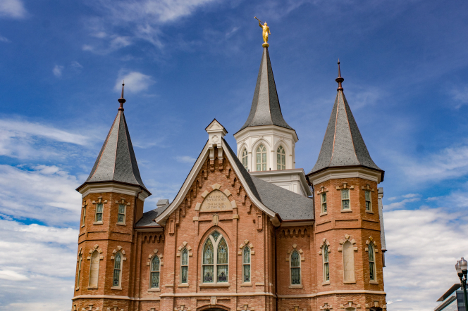 A front view of three spires on the Provo City Center Temple on a sunny day.