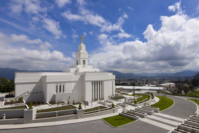 A view of the entire Quetzaltenango Guatemala Temple, including a view of the grounds and the city below.
