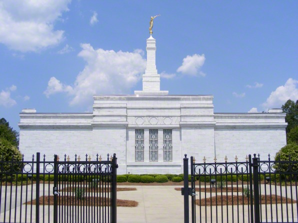 Windows on the side of the Raleigh North Carolina Temple, with a view of the fence around the grounds of the temple.