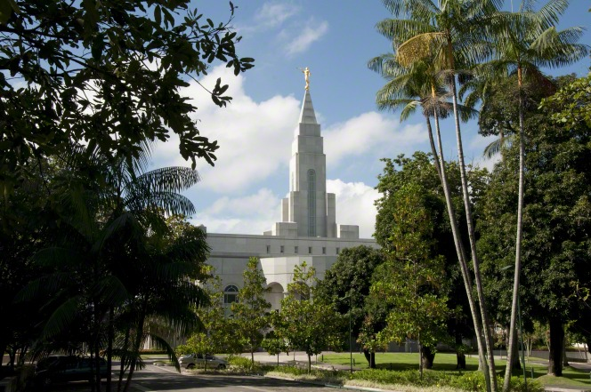 A partial view of the Recife Brazil Temple, with trees and bushes on the temple grounds in the foreground.