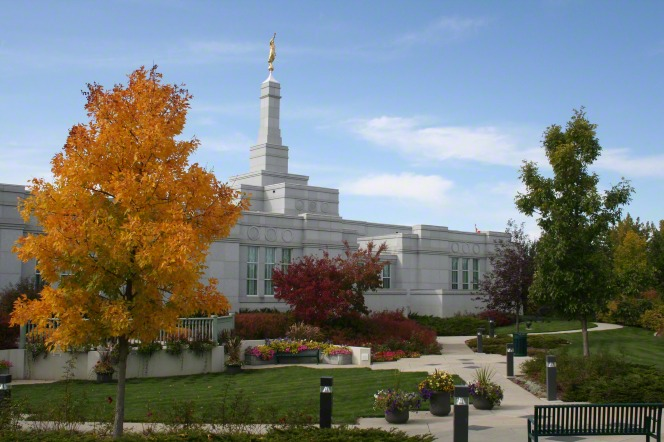 The entrance to the Regina Saskatchewan Temple, with a view of the path leading to the door and the trees changing colors on the grounds of the temple.