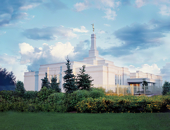 The Regina Saskatchewan Temple, with a view of the entrance and the fence around the grounds.