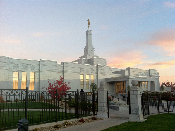 The entrance to the Reno Nevada Temple, with a view of the grounds and the sunset reflecting in the windows.