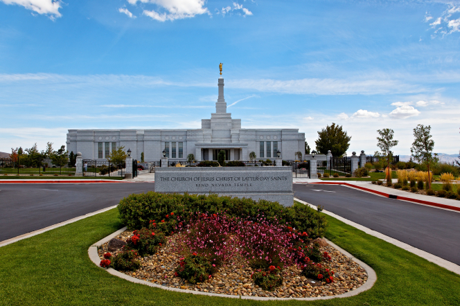 The entire Reno Nevada Temple, including the temple name sign out front and a road leading up to the entrance of the temple.
