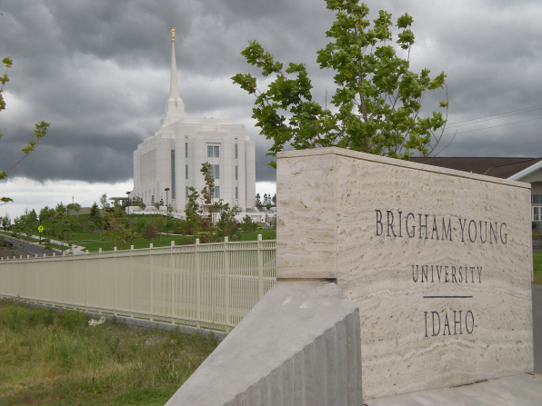 The entire Rexburg Idaho Temple, with the surrounding grounds and the Brigham Young University–Idaho name sign in the foreground.