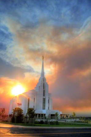 The entire Rexburg Idaho Temple, with the sun setting behind it.